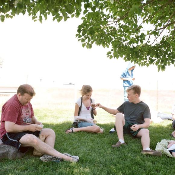 Sitting in the grass in Beaver, Utah